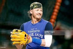 Josh Donaldson #20 of the Toronto Blue Jays smiles as he warms up before the start of a MLB interleague game against the Arizona Diamondbacks at Chase Field on July 19, 2016 in Phoenix, Arizona.