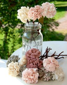 what about making fabric Peonies to add to your centerpeices since they are out of season?