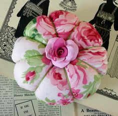 Rose Pincushion the rose is gorgeous, wonder if it clay button homemade or bought button? Fabric Crafts, Sewing Crafts, Sewing Projects, Sewing Kits, Patchwork Quilt, Thread Catcher, Half Dolls, Needle Book, Stick Pins
