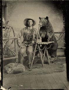 ca. 1860-80's, [tintype portrait of a hunter and his dog, both sitting with a taxidermied bear looming menacingly behind], *Related: 1...