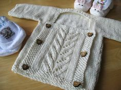 """Adorable hand knit baby sweater with front panel. Pattern """"Presto Chango"""" by Valerie Wallis. This sweater knit by Sarah shown on her blog."""