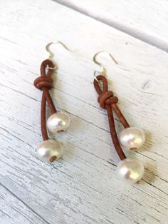 A personal favorite from my Etsy shop https://www.etsy.com/listing/252157574/leather-freshwater-pearl-earrings-pearl