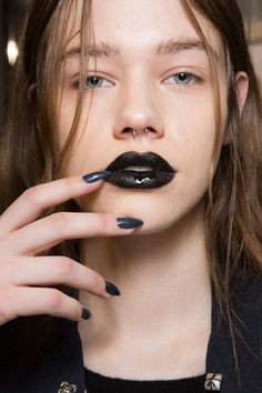 Inspired by Vivienne Westwood's 'Japanese Buddhist punk spirituality,' Val Garland created a black lip using M.A.C Cosmetics.