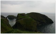 """Carrick-a-Rede Rope Bridge is a rope suspension bridge near Ballintoy, County Antrim, Northern Ireland. The bridge links the mainland to the tiny Carrick Island.  """"Carrick-a-Rede"""" means """"rock in the road""""."""