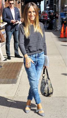 The total stunner - Sarah Jessica Parker rocking a grey sweater with statement flats for an everyday casual and stylish look.