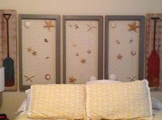 """My """"headboard""""- old distressed window frames with chicken wire. I used E6000 glue to attach starfish  shells."""