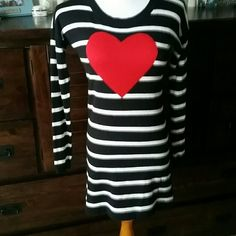 Express Heart sweater dress NWOT No holes. No stains. Fits true to size. 58% cotton/35% rayon/7% nylon. Black/white/red. ⚠Single item offers thru offer tab only/bundles recieve 15% off using bundle feature⚠ ❌No trades ❌No other sites ❌No pay pal (45) express  Dresses Mini
