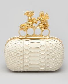 Unique Alexander Mcqueen Python Cherub Knuckleduster Clutch Ivory. Only 10 pieces ever made. An outstanding Wedding bag.  I love, love, loooove it...  ~~~ ✿RePin from Golden Shadow✿