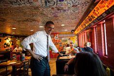President Barack Obama greets patrons at the Sink Restaurant & Bar in Boulder, Colo., April 24, 2012.