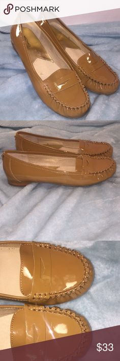 MICHAEL MICHAEL KORS Tan Patent Leather Loafers MICHAEL -MICHAEL KORS Tan Patent Leather Loafers in ladies size 10.5. This is Michael Kors' classic penny loafer style in genuine patent leather upper and with a rubber sole. Michael Kors gold tack detailing, and half inch heel. These are in excellent preowned condition with very little evidence of prior usage as seen in the photographs. Originally $98. MICHAEL Michael Kors Shoes Flats & Loafers