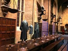 The Great Hall at Hogwarts contains gargoyles and scholarly garb worn by Harry and other students at the fictional wizardry school.        Scroll upScroll down