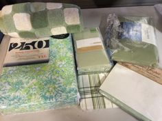 large lot of items for the home includes a pair of olive and cream bath towels new with tags a twin xl fitted sheet in olive two standard