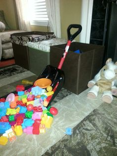 Does your child have so many little toys that cleanup takes FOREVER?  Fret no more! Get a small plastic snow shovel and scoop the toys up to dump away into storage boxes... I cut cleanup time to 5 mins!  Yay!