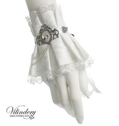 Elegant pure white cuff bracelet is perfect for any snow queen. Made of soft fabric and is comfortable to wear. It is a unique Vilindery design and has been handmade with a lot of love and care. Cuff is adjustable with long satin ribbons. The length of the cuff around the wrist is 5.9 (15