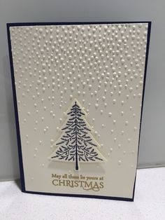 "Stampin' Up! Elegant Christmas card using Softly falling embossing folder with ""Peaceful pines"" and ""Versatile Christmas"" stamp sets with coordinating Night of Navy card stock and ink, Vanilla card stock and gold embossing powder."