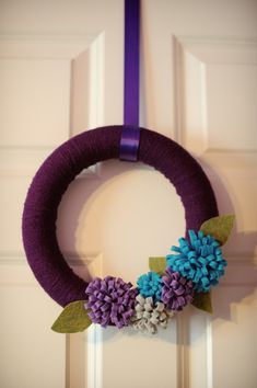This is a sequel to the Yarn Wreath with Felt Flowers I blogged about a few weeks ago. I think I mentioned in that post that I was plannin...