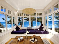 Spring, summer and fall -- this sunroom captures the beauty of the shores beyond while offering a private sanctuary for reflection. #patio #interiordesign #architecture