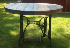 cable reel + singer sewing machine stand = table