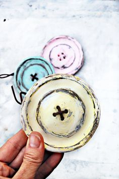 Shabby chic wall button decor from jar lids.