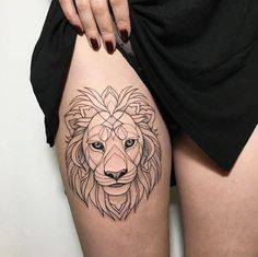 Lion tattoo on thigh by Ira Shmarinova