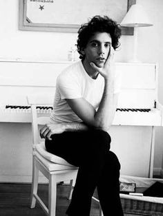 Mika and his beloved white chipboard piano