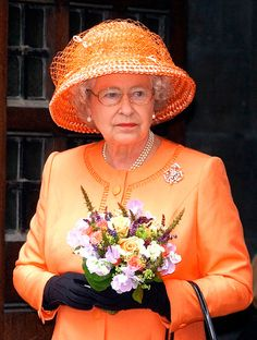 Elizabeth II orange hat.......SHE LOOKS SO PRETTY IN THIS COLOR..............ccp