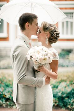 Romantic rainy day wedding portraits | Anastasiya Belik Photography | see more on: http://burnettsboards.com/2014/04/romantic-rainy-day-wedding-portraits/ #kiss #weddings