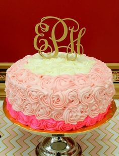 A custom monogram cake topper is the perfect finishing touch to this beautiful cake!
