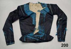 Tröja i glättad yllekypert kantad med sidenband. Oxie, 1800-1840. Nordiska Museet, nr. NM.0000200