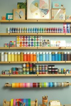 How to clean and organize your craft room. Ideas for saving space and time. Run small strips of wood down the wall, lean paint bottles against wall. One day that craft corner will happen...one day when i actually can have a craft room Lol
