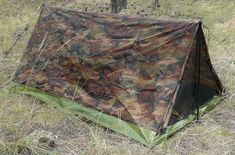 """Texsport Camouflage Trail Tent - Ship Wt: (3.6 lbs.); (54""""W x 38""""H x 84""""L); 2-person; Constructed of polyurethane coated polyester taffeta with tub-style rip-stop polyethylene floor; Zippered mesh rear window w/ storm flap; Flame retardant, meets CPAI-84 specs; Includes: 6 pole-sections; 4 plastic tensioners; guy ropes, 10 stakes; storage bag; - Amazon: ±$31.00 - Review, credit to: Bug Out Bag Method (with minor mods, could be suitable for your bug-out-bag needs) -"""