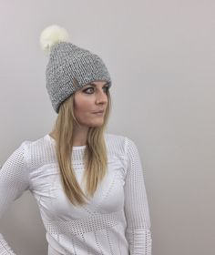 A personal favorite from my Etsy shop https://www.etsy.com/listing/493061311/knit-beanie-hat-with-white-faux-fur-pom