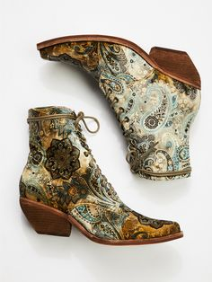 Grove Lace-Up Western Boot | In a bold design, these fabric ankle boots with lace-up detailing. * Pointed toe * Western-inspired stacked heel * Metal grommets