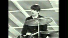 "The Beatles first appearance on the Ed Sullivan Show on February 9, 1964, performing ""I Want to Hold Your Hand."""