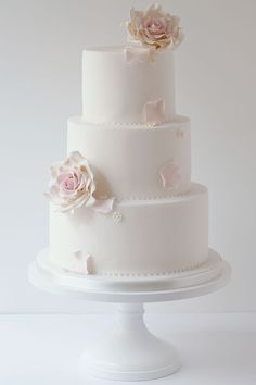 Wildflower Cakes London Simple wedding cake with cascading sugar roses and daisies