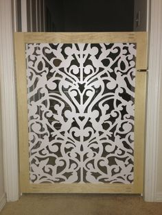DIY Custom Pet gate.  1x3 lumber, lattice from Home Depot website and latch.
