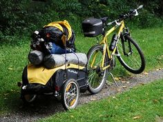 a mountain bike towing a two-wheeled loaded touring trailer - bug out vehicle #bov