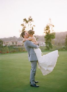 Bride and Groom kiss on the golf course // Weddings at The Crosby in Rancho Santa Fe, California