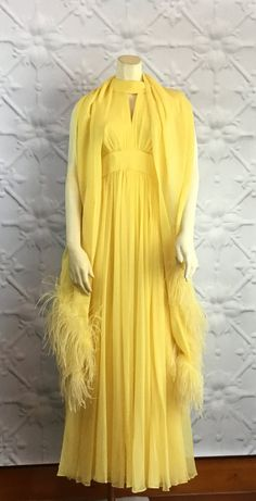 Make a grand entrance with this lemon yellow flowing chiffon full length evening gown! The dress is beautiful on its own... the show-stopping