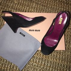 MIU MIU Black Suede Heels Size 37 $380 - with BOX! MIU MIU Black Suede Heels Size 37 $380 - with BOX! preowned but in good condition. Comes with box and dust bags.  Heel height is about 4 inches Miu Miu Shoes Heels