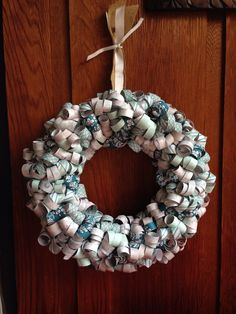 Made this curly paper wreath using the Winter Frost designer series paper from the Stampin' Up! Holiday catalog.