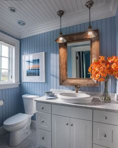 Pretty nautical bathroom. Like this for the pop of orange. Thought I wanted blue and brown in my bathroom, but now I'm not sure?