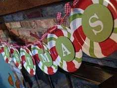 idea for a christmas garland with plates. One letter on each plate with candy theme around the outside.