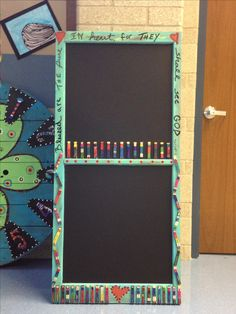 Old window painted with chalkboard paint. Have kids paint clothes pins to look like themselves. This project sold for $425 at our school auction.