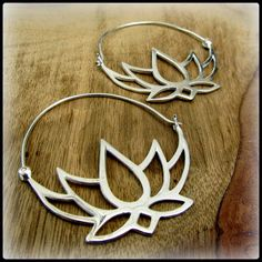 Sterling silver lotus hoop earrings. Like tribal style fake gauges but fit standard size piercings. Layer beautifully through gauged tunnels.