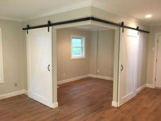Created a versatile space in an open room with barn doors - Haus und Garten - Basement Bedrooms Basement Makeover, Basement Renovations, Home Renovation, Home Remodeling, Small Basement Remodel, Garage Remodel, Exterior Remodel, Basement Apartment, Kids Basement