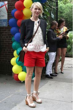 Like the ensemble.. bright shorts, boxy top, structure jacket, heels, and casual purse.