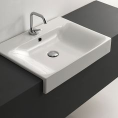 Features:  -Includes mounting hardware.  -Bathroom sink.  -Made of ceramic white.  -With overflow.  -Designer high end premium quality.  -ADA Compliant.  Installation Type: -Vessel sink.  Style: -Cont