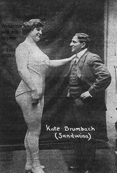 This is Katie Sandwina, vintage strongwoman extraordinaire. She worked for Barnum and Bailey's until about 1940. According to legend, she met her husband while taking on all comers in wrestling (an area in which, much like Mongolian princess Khutulun, she remained undefeated). One of her standard performance feats was lifting her husband (who weighed 165 pounds) overhead with one hand.