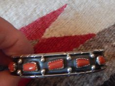 This is really nice the bracelet is what we call antiqued which we finished that as it was only partly there its fine now..... we put in the coral stones and its stunning,, It is very pretty `` Navajo /Cherokee made sterling silver coral Native American Jewelry, it is a fraction over 1/2tall good weight to this pretty one inside is 5 1/2 opening is 1 1/2 really pretty U.S.A..s/h includes insurance to U.S.A.